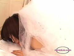 Asian Girl With Headdress Licking And Fucking Bride Pussy With Strapon On The Bed In The Bedroo