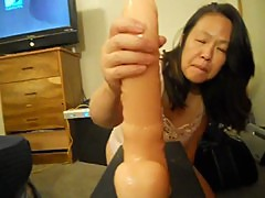 ASIAN WIFE TRYING TO TAKE DILDO