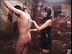 Cute asian dominatrix whips sex slave in bondage basement