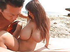 Busty asian at the beach