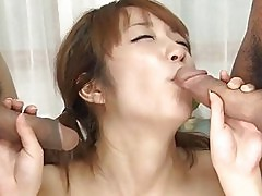 Girl sucks 2 big dicks