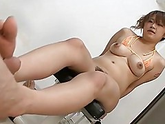 Asian babe in bikini works on a cock