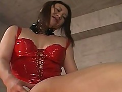 Horny Japanese MiLF in red latex around the strap on does some damage