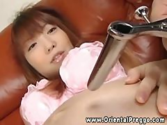 He gets toy deep into her pregnant asian pussy before fucking her
