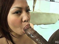 Asian slut slurpin on chocolate cock