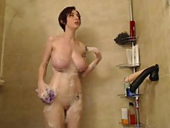Natural big breast redhead rides fake penis