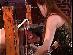 Big tits asian dominating a guy using various BDSM implements