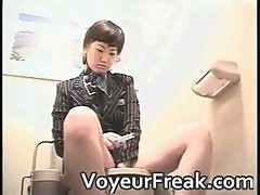 Sexy asian chick takes a leak