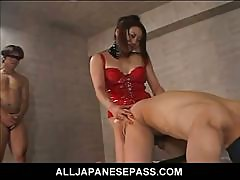 Horny Japanese MiLF in red latex with a strap on does some damage