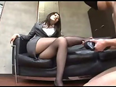 Office Lady In Pantyhose Sitting On The Couch Giving Footjob For Blindfolded Guy In The Office