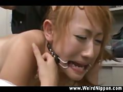 Oriental receiving forceful clit stimulation