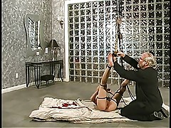 Beautiful blonde asian bondage girl is restrained and strung up by her master